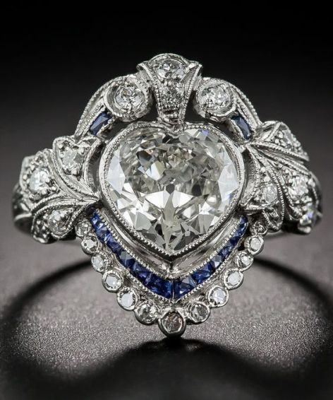 An Edwardian Diamond and Sapphire engagement ring set in platinum with a millegrain setting.