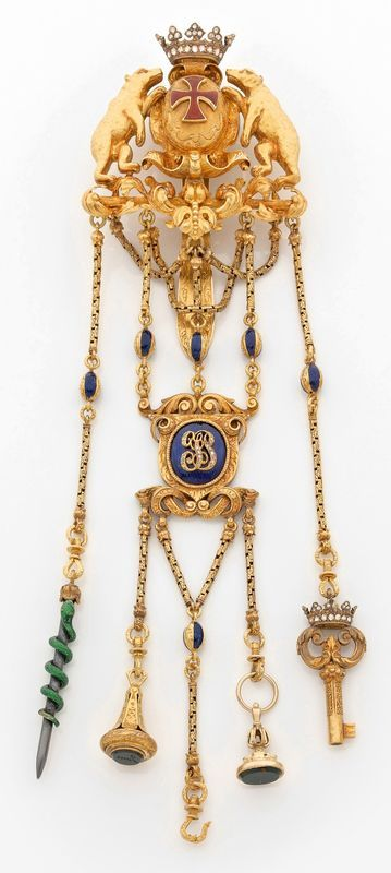 A mid-19th century enamel and 18K gold châtelaine.