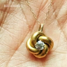 DIAMOND AND 14KT YELLOW GOLD LOVE KNOT PENDANT (VINTAGE)
