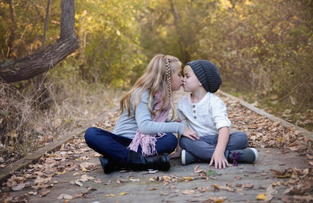 brother and sister kissing