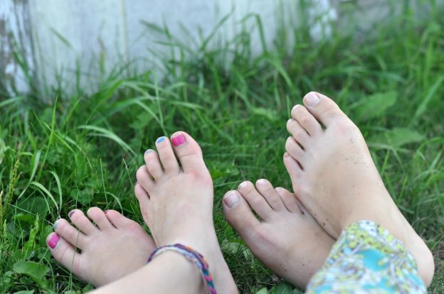 Mother and daughter with bare feet