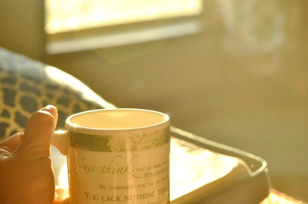 Holding tea mug at sunrise by Katie M Reid Photography