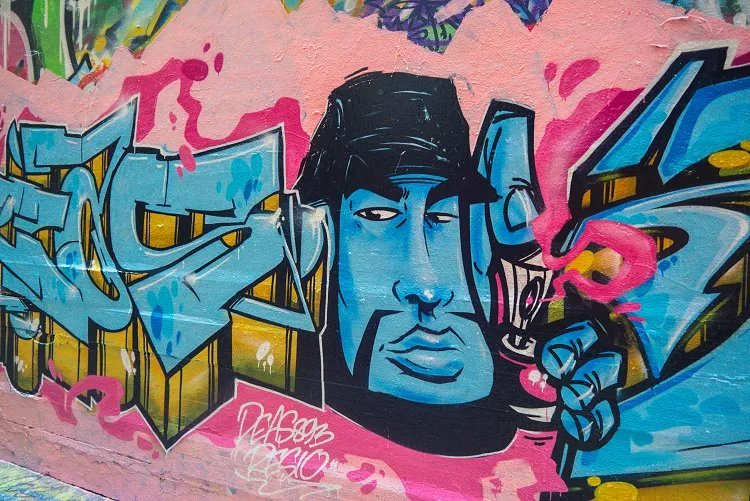 Image of blue face cartoon character against pink background street art on Union Lane Melbourne