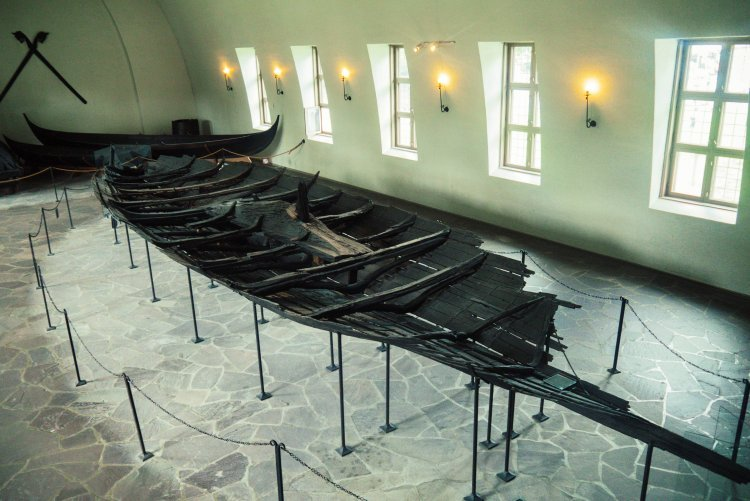 Image of the remains of the bow of a viking ship in the Viking Ship Museum in Oslo Norway