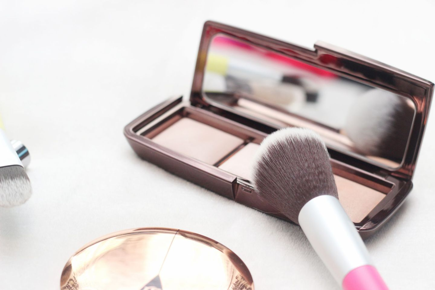 Benecos powder brush and Hourglass Ambient Lighting Palette
