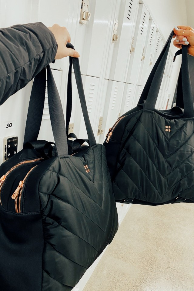 Fashion blogger KatWalkSF holds her Sweaty Betty Luxe Kit Bag with Ckanani
