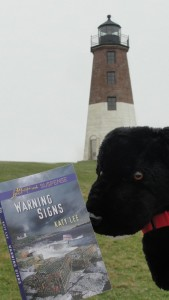 The Black Dog caught reading WARNING SIGNS  at Point Judith Lighthouse, R.I.