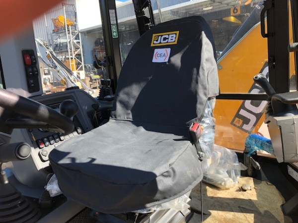 Canvas seat cover for a JCB Backhoe Loaders