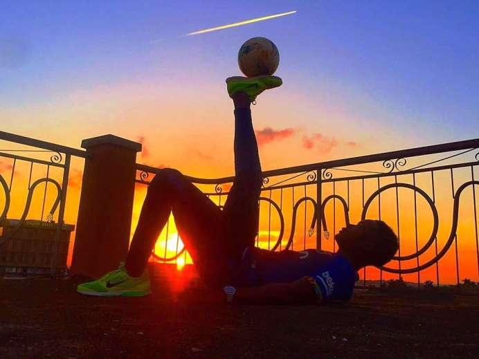Uganda's finest free style ball juggler Andy Skillz lands invite to 2019 Africa Olympic beach Games #Uganda Andyskills juggles in sunset background