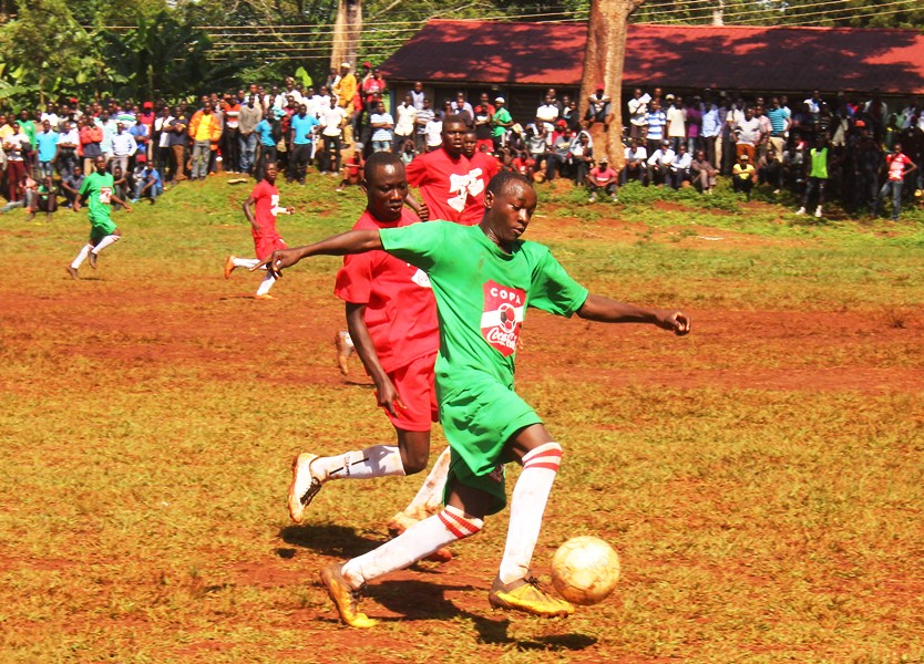 The passionate crowd to push the home team all the way #Uganda Isma Mugulusi in action against Alliance High School