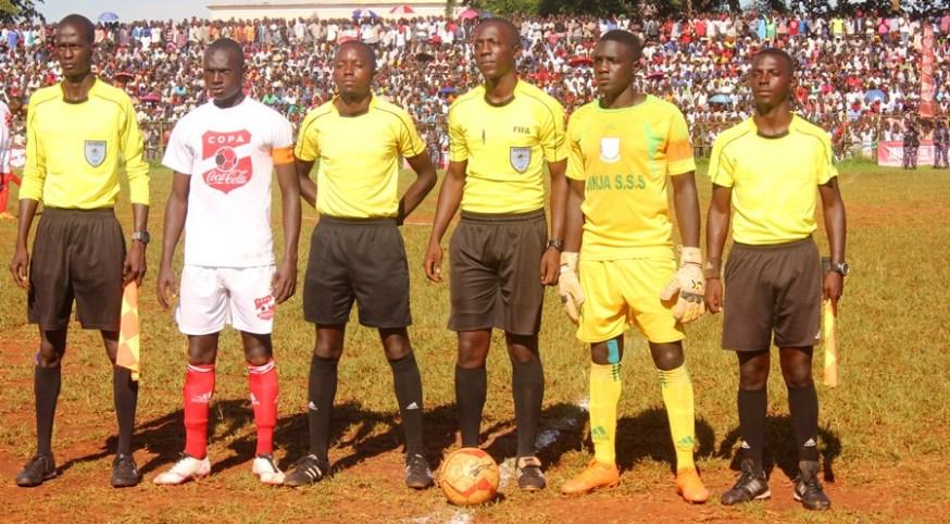 Tear Gas, Gun-shots mar Jinja SS' slim win over 10 man Standard High Zana #Uganda Jinja SS and Standard High School Zana captains with the match referees