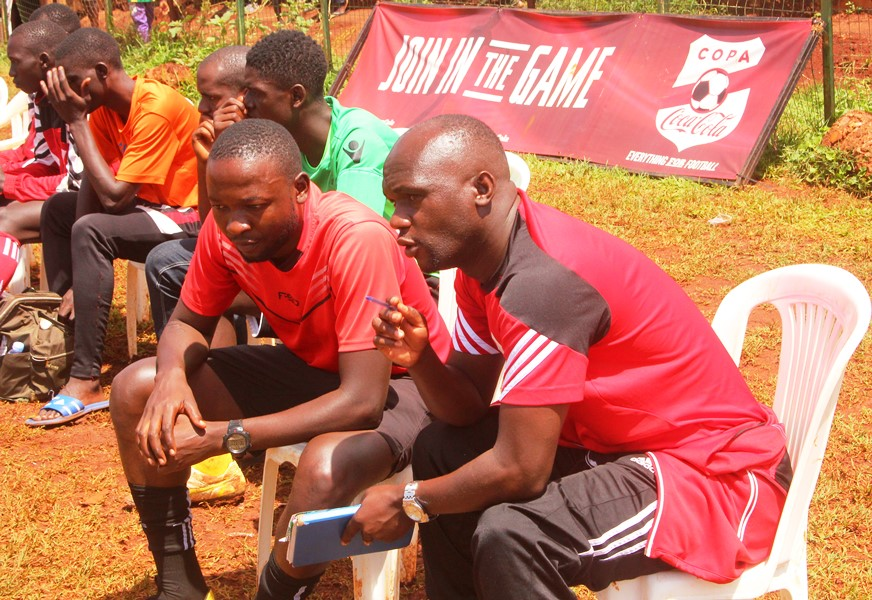 The passionate crowd to push the home team all the way #Uganda Jockim Mukungu and Steven Mubiru combine notes before their match against Kawempe Royal at the round of 16 stage