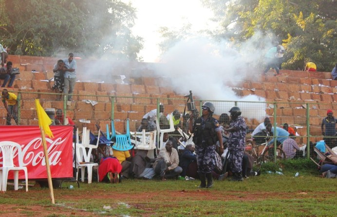 Tear Gas, Gun-shots mar Jinja SS' slim win over 10 man Standard High Zana #Uganda St Marys SS Kitende Director Lawrence Mulindwa and other fans take cover