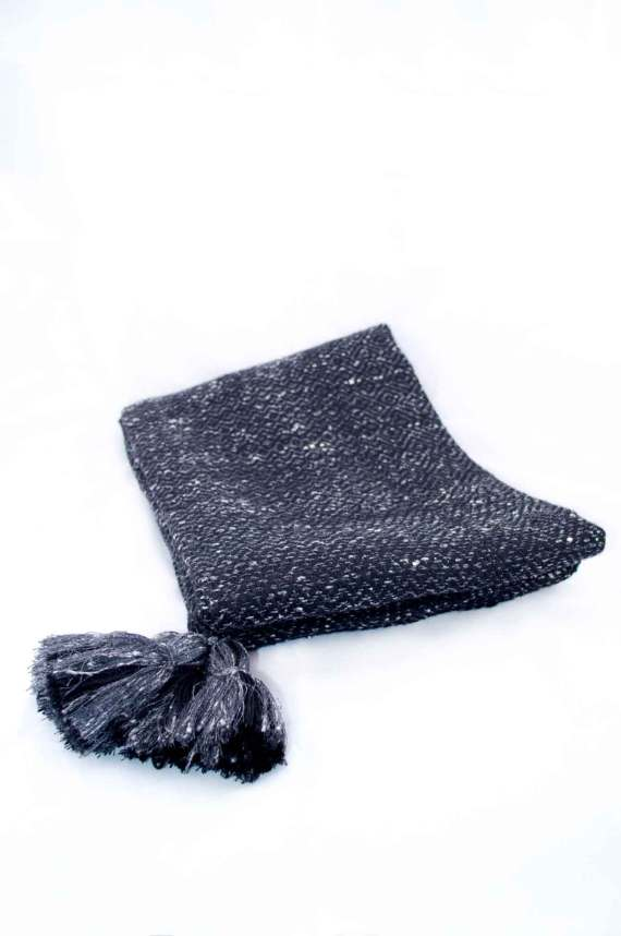 Throw blanket created with dark gray flecked silk floss, black wool. Succession of lozenge patterns.  Technique: Throw blanket hand-woven in a traditional way on non-mechanical looms in the 7th arrondissement of Paris in France.  Finishes: Right edge. Double stitching. 4 pompons 11 cm long.  Size: 140 x 180 cm.  Single piece / 1 copy only.