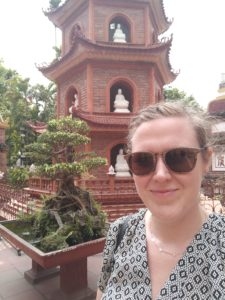 woman with narcolepsy in front of a temple