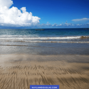 incredible blue sky with fluffy clouds, smooth beach, and blue sea