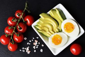 tomatoes, sliced avocado, boiled egg, pink salt
