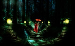 Monk in a dark forest on dimly lit path