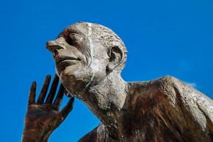 bronze sculpture with hand up to ear for active listening