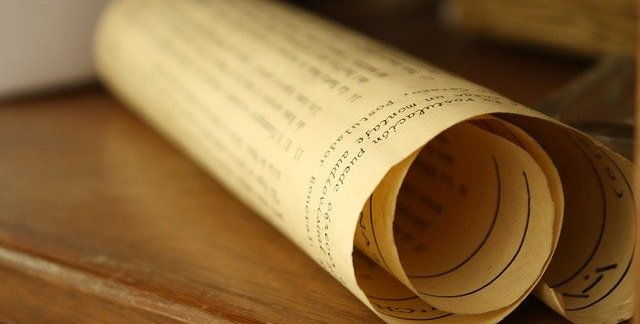 rolled up piece of printed parchment to illustrate a manuscript