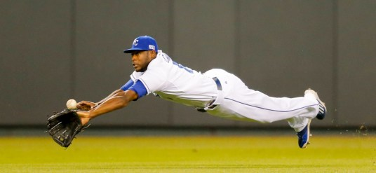 Kansas City Royals center fielder Lorenzo Cain (6) leaps and misses a ball hit for a single by Los Angeles Angels' Erick Aybar during the second inning of Game 3 of baseball's AL Division Series in Kansas City, Mo., Sunday, Oct. 5, 2014. (AP Photo/Travis Heying) ORG XMIT: MONH115