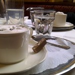 Cafe Central Coffee on a silver platter served with water