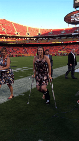 Graduate receives scholarship at Chiefs game