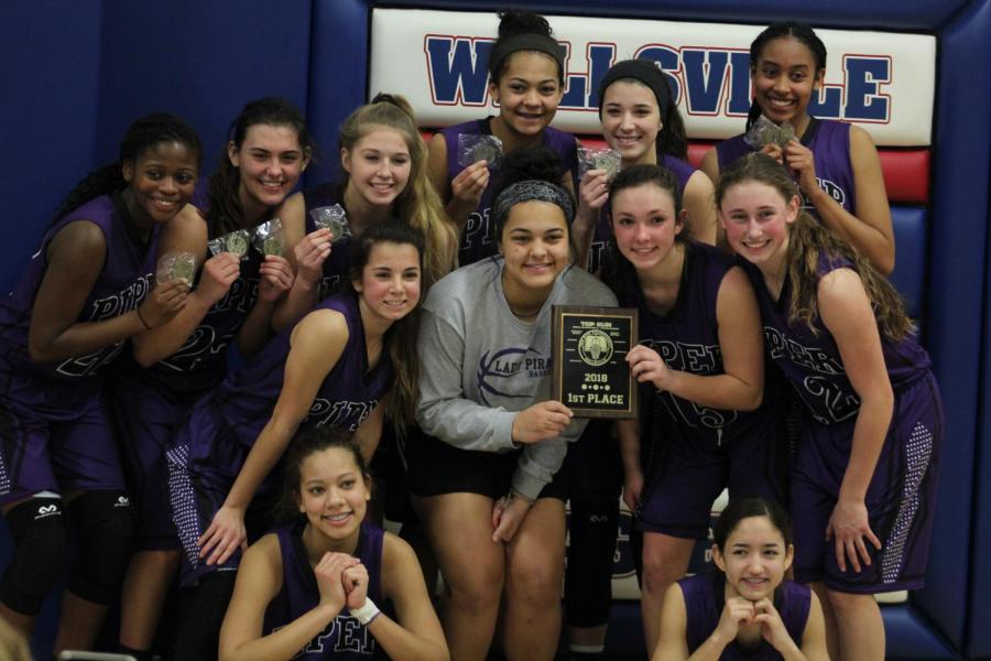 Lady+Pirates+share+laughs+and+smiles+after+their+championship+win+against+Baldwin.