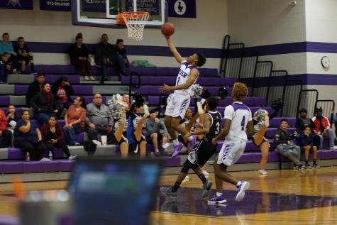 Boys' varsity basketball defeats the Bishop Ward Cyclones