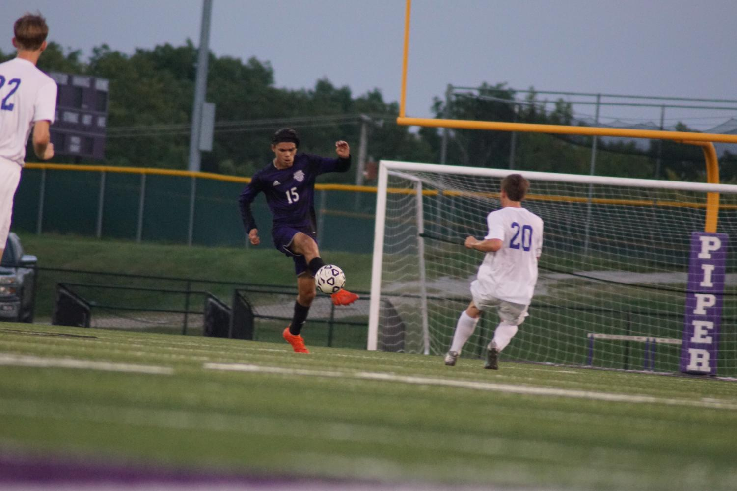 Senior Anthony Montez kicks the ball away from their goal keeping Leavenworth from scoring.