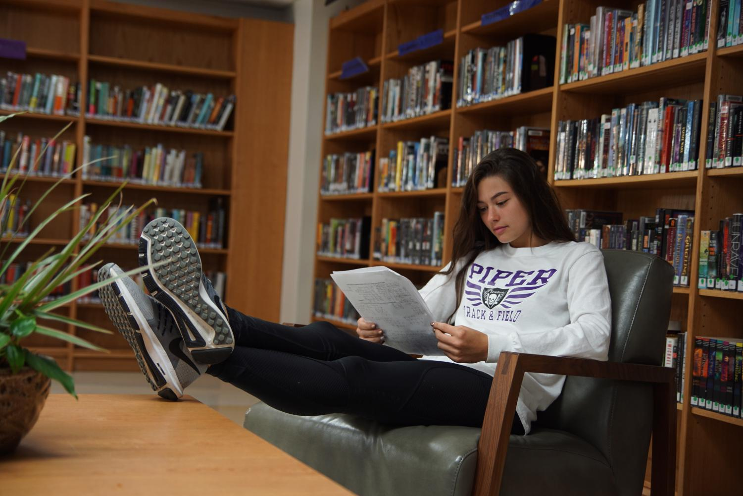 Senior Lexi Nigh studies for finals in the library.