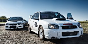 A Subaru and a Mitsubishi ready for RallyCross