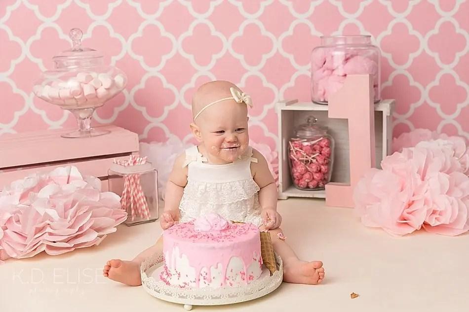 Candy themed cake smash photo of baby girl.
