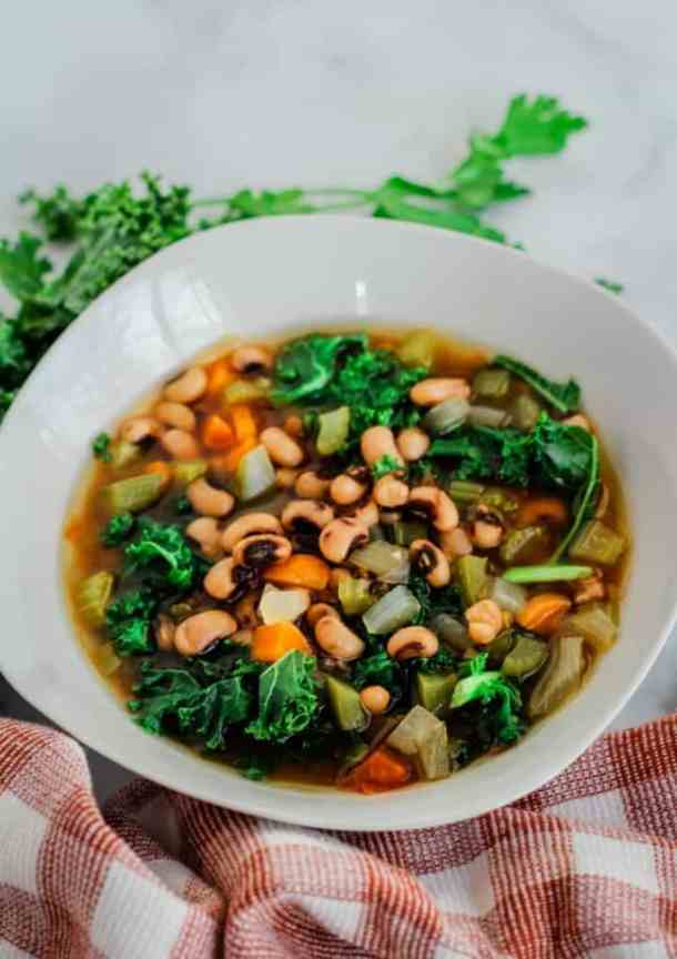 black eyed pea soup in white bowl