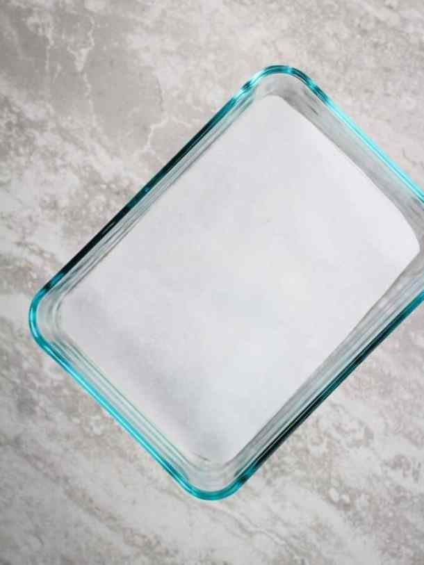 glass container lined with parchment paper