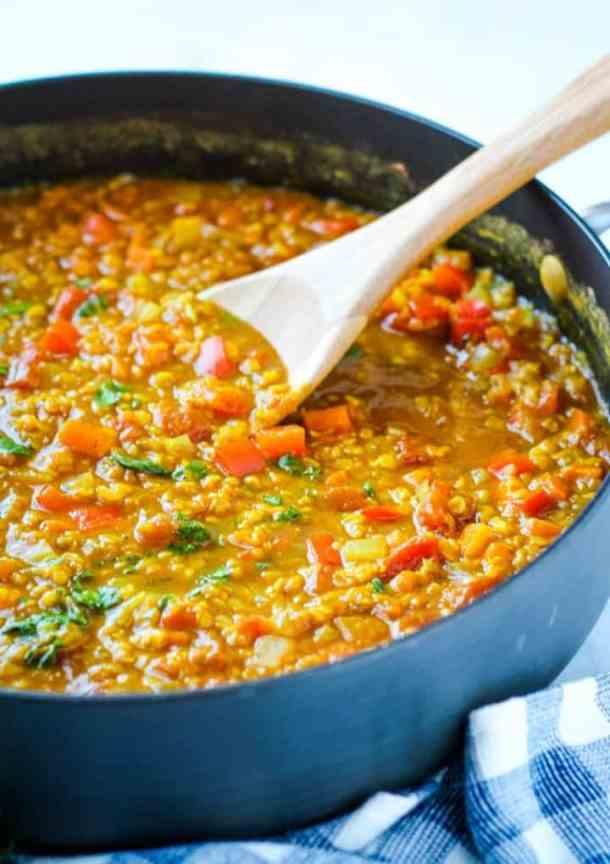 wood spoon stirring lentils