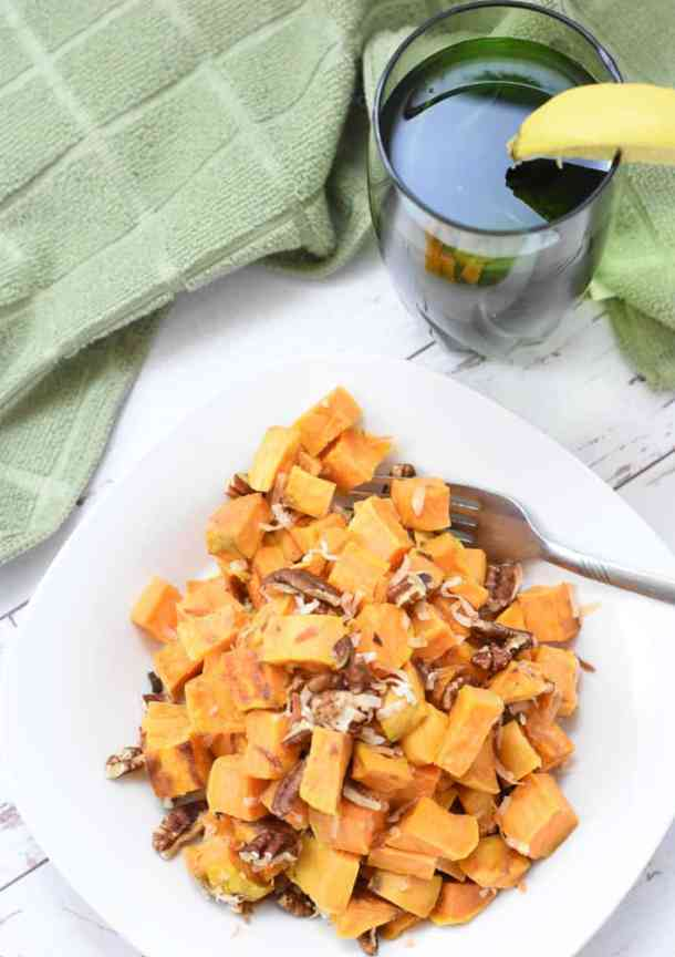 vegan sweet potatoes with glass of water