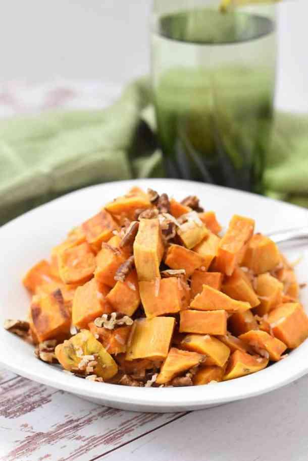 vegan sweet potatoes and glass of water
