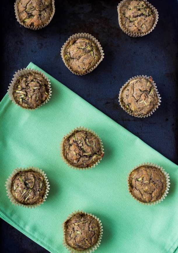 zucchini muffins on green placemat