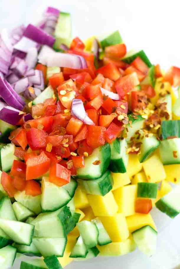 mango cucumber salad ingredients in glass bowl
