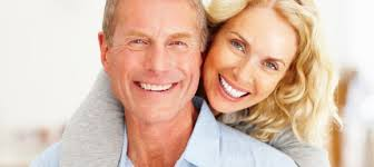 Couple with teeth implants smiling