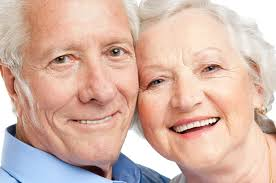 happy older couple with dentures