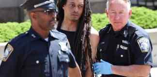 Suspect Foy being taken into custody.