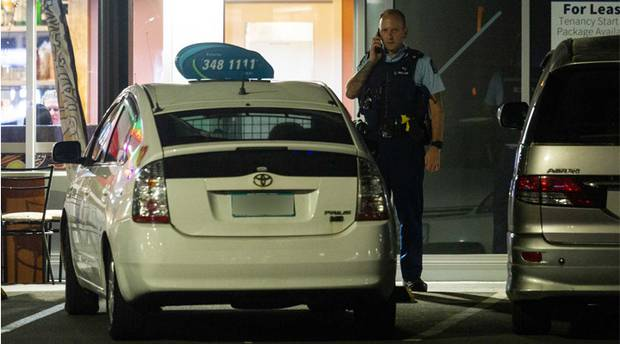Police on the scene outside House of Spice in Rotorua after a taxi driver was shot. Photo / Stephen Parker
