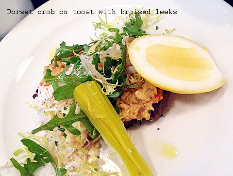 Dorset crab on toast with braised leeks