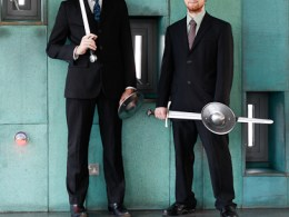 Ben Kerr and Keith Farrell posing for a photoshoot, with suits and swords. Photo by Reuben Paris, 2010.