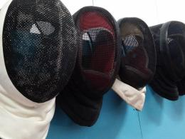 A row of fencing masks at The Vanguard Centre in Glasgow. Photo by Keith Farrell, 2015.
