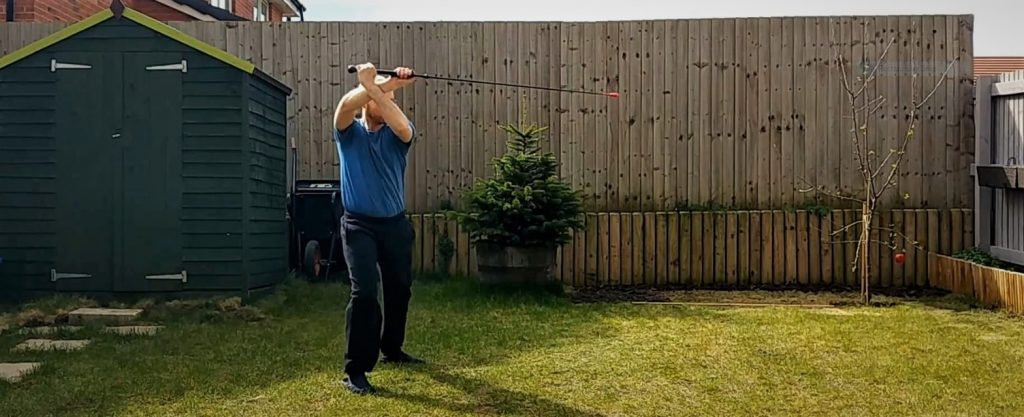Keith Farrell practising some flourishes with the longsword in the garden