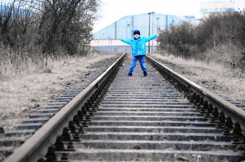 Photo of child on railway line