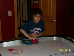 Sydney playing Air Hockey